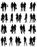 Silhouettes of happy family. Silhouettes of happy young beautiful walking women and men . Vector illustration Stock Illustration