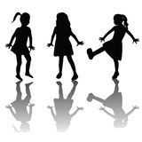 Silhouettes of happy kids Stock Image