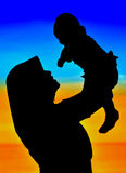 Silhouettes of happy Mom and Baby Royalty Free Stock Image