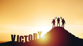 Silhouettes of happy three people on top of a mountain stock photography