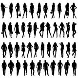 Silhouettes of happy young women  and men. Royalty Free Stock Photography