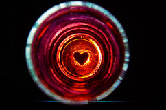 Silhouettes heart in the glass Royalty Free Stock Photography