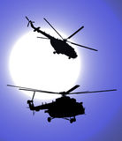 Silhouettes of helicopters in the night Stock Images