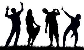 Silhouettes heureuses de gens Photographie stock libre de droits