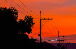 Silhouettes of high voltage power lines Royalty Free Stock Photography