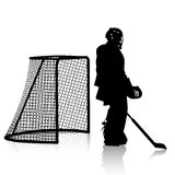 Silhouettes of hockey player. Isolated on white. Royalty Free Stock Photography