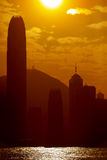 Silhouettes of Hong Kong skyscrapers against golden sky Stock Photos