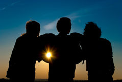 Silhouettes on a horizon sunset Stock Photo