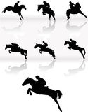 Silhouettes of horse racing Stock Photography