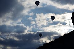 Silhouettes of the hot air balloons flying Royalty Free Stock Image