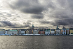 Silhouettes of houses on the waterfront Stockholm, dramatic cloudy sky Stock Photography