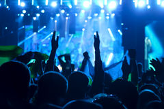 Silhouettes of human heads and hands at a rock concert Royalty Free Stock Photo