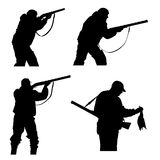 Silhouettes of hunters Stock Images