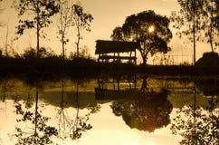 Silhouettes hut in farm pool Stock Photo