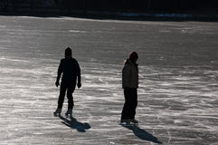 Silhouettes of ice skaters Royalty Free Stock Photos