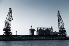 Silhouettes of industrial cranes, Balchik port, Bulgaria Royalty Free Stock Image