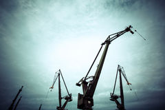 Silhouettes of industrial cranes in Gdansk  shipyard. Industrial view at night in shipyard of Gdansk, Poland Royalty Free Stock Photography