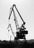 Silhouettes of industrial port cranes. Danube River Stock Image