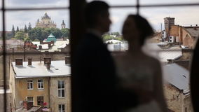Silhouettes just married couple near big window stock footage