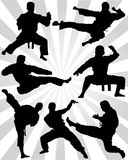 Silhouettes of karate fighting. Black silhouettes of karate fighting on a white background Stock Photography