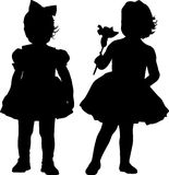 Silhouettes of kids Stock Images