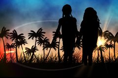 Silhouettes of  kids holding hands against sunset view with palm trees Stock Images