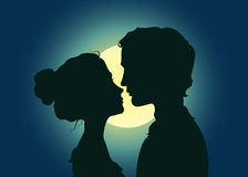 Silhouettes of kissing couple Stock Images