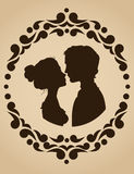 Silhouettes of kissing couple Stock Photography