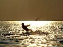 Silhouettes kitesurf on a gulf. On a sunseet Royalty Free Stock Photos