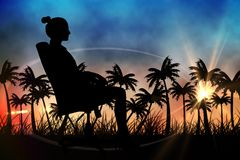 Silhouettes of lady sitting in office chair against sunset view with palm trees Royalty Free Stock Photography