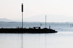 Silhouettes on a lake Stock Photo