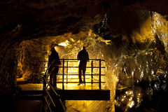 Silhouettes in the Lauterbrunnen cave Royalty Free Stock Photos