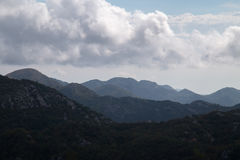 Silhouettes of layered mountains at daytime Stock Image