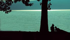 Silhouettes in love. A young couple enjoying a romantic afternoon on the shores of lake Ohrid royalty free stock images