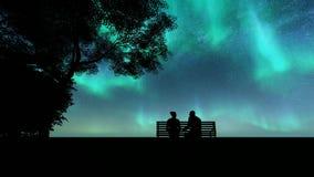 Silhouettes lovers northern lights Beautiful illustration on dark backdrop. Night landscape. Romantic illustration