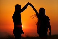 Silhouettes of a loving couple at sunset . the concept of love and romance. stock photography