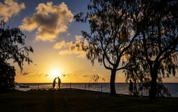 Silhouettes of a loving couple at sunset. Royalty Free Stock Photography