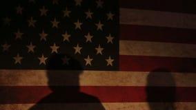 Silhouettes of  man  exercising workout aerobic fitness posture full length silouhette on studio on the USA flag stock video