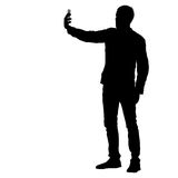 Silhouettes man taking selfie with smartphone on white background. Vector illustration Stock Photo