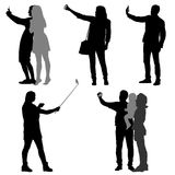 Silhouettes man and woman taking selfie with smartphone on white background. Vector illustration Stock Photography
