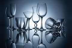 Silhouettes of martini, cognac, champagne and wine empty glasses. With reflections royalty free stock photos