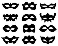 Silhouettes of masks. Black silhouette of festive masks in black on a white background Royalty Free Stock Images