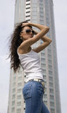 Silhouettes of a megacity. The young girl on a  skyscraper in City background Stock Images
