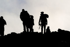Silhouettes of men on the Etna Stock Images