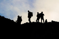 Silhouettes of men on the Etna Stock Photo