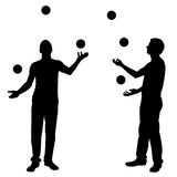 Silhouettes of men juggling balls. Isolated on white Royalty Free Stock Images