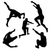 Silhouettes of men jumping. On white background Royalty Free Stock Photo