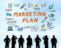 Marketing plan concept on a wall. Silhouettes of men looking at a marketing plan concept stock photography
