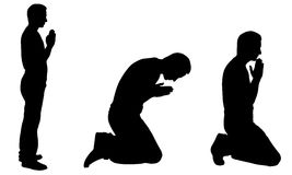 Silhouettes of men praying. Isolated on white Royalty Free Stock Images