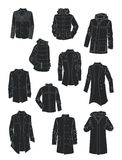 Silhouettes of men's jackets and coats Royalty Free Stock Photography